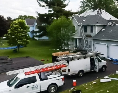 Infinite Roofing crew going to roofing job site