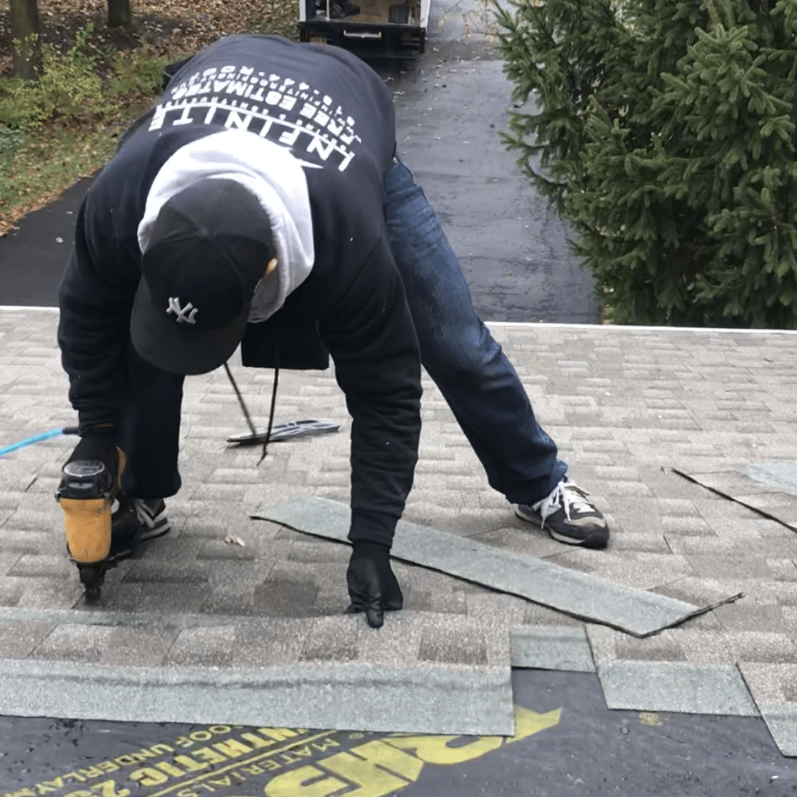 infinite_roofing_worker_on_roof_shingling_service_brief